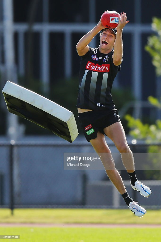 Adam Oxley of the Magpies marks the ball during a Collingwood Magpies AFL training session on May 5, 2016 in Melbourne, Australia.