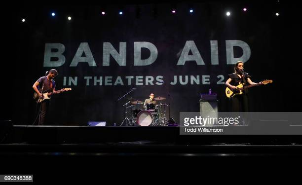 Adam Pally Zoe ListerJones and Fred Armisen perform at the after party for the premiere of IFC Films' 'Band Aid' on May 30 2017 in Los Angeles...