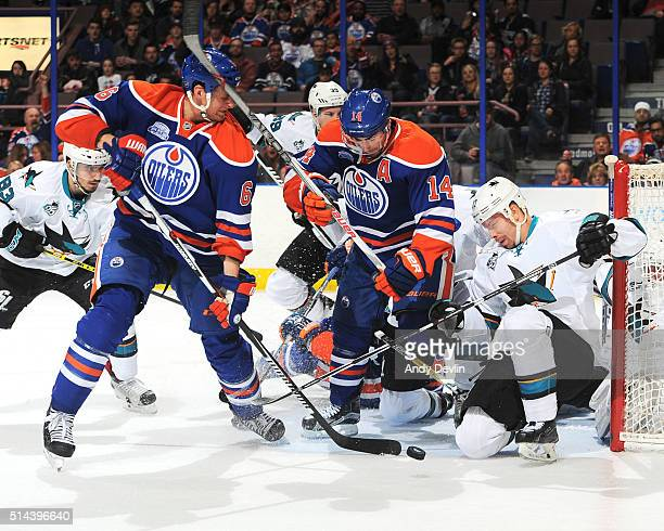Adam Pardy and Jordan Eberle of the Edmonton Oilers battle for position against Joonas Donskoi of the San Jose Sharks on March 8 2016 at Rexall Place...