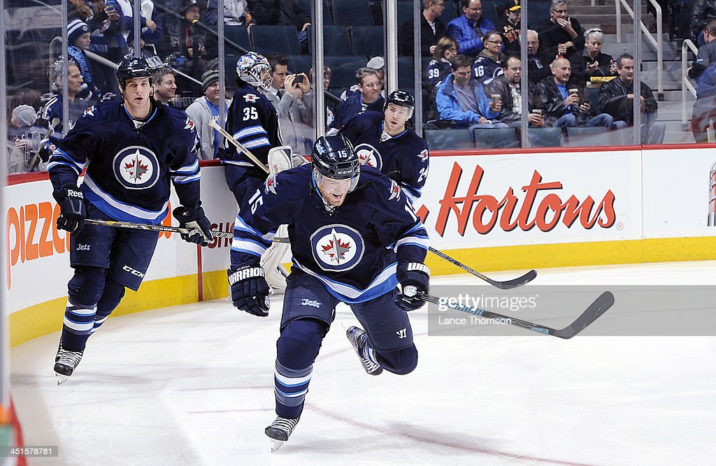 Adam Pardy and Matt Halischuk of the Winnipeg Jets take part in the pregame warm up prior to NHL action against the Minnesota Wild at the MTS Centre...