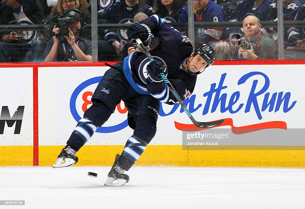 <a gi-track='captionPersonalityLinkClicked' href=/galleries/search?phrase=Adam+Pardy&family=editorial&specificpeople=2221762 ng-click='$event.stopPropagation()'>Adam Pardy</a> #2 of the Winnipeg Jets shoots the puck down the ice during third period action against the Columbus Blue Jackets at the MTS Centre on January 11, 2014 in Winnipeg, Manitoba, Canada.