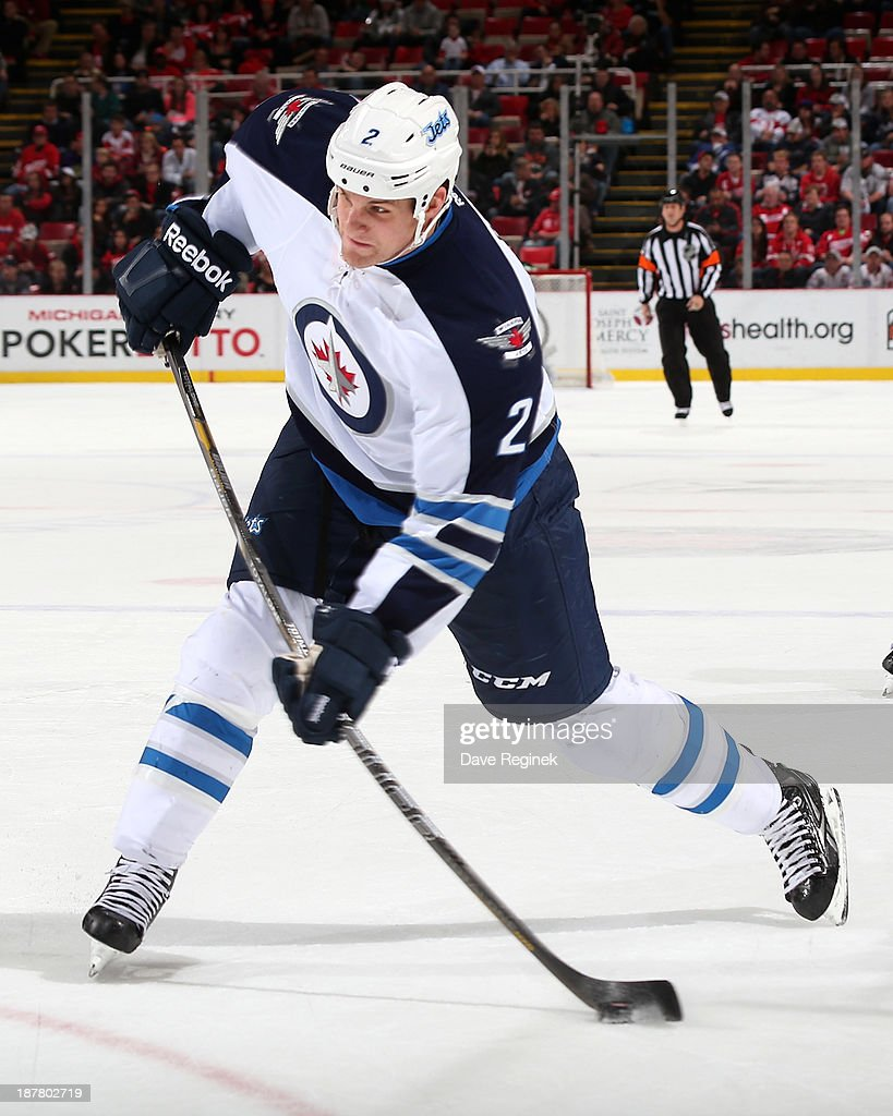 <a gi-track='captionPersonalityLinkClicked' href=/galleries/search?phrase=Adam+Pardy&family=editorial&specificpeople=2221762 ng-click='$event.stopPropagation()'>Adam Pardy</a> #2 of the Winnipeg Jets takes a slap shot during an NHL game against the Detroit Red Wings at Joe Louis Arena on November 12, 2013 in Detroit, Michigan.