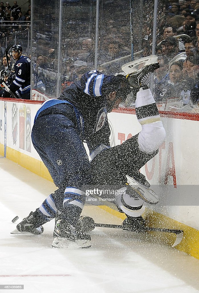 <a gi-track='captionPersonalityLinkClicked' href=/galleries/search?phrase=Adam+Pardy&family=editorial&specificpeople=2221762 ng-click='$event.stopPropagation()'>Adam Pardy</a> #2 of the Winnipeg Jets takes down <a gi-track='captionPersonalityLinkClicked' href=/galleries/search?phrase=Jayson+Megna&family=editorial&specificpeople=10121973 ng-click='$event.stopPropagation()'>Jayson Megna</a> #59 of the Pittsburgh Penguins along the boards during third period action at the MTS Centre on April 3, 2014 in Winnipeg, Manitoba, Canada.