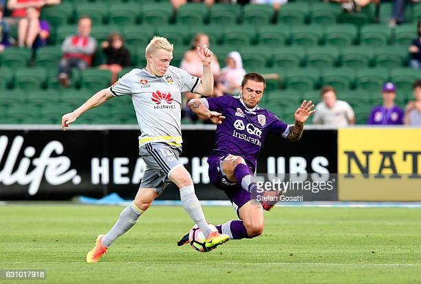 Adam Parkhouse of the Phoenix and Josh Risdon of the Glory compete for the ball during the round 14 ALeague match between the Perth Glory and the...