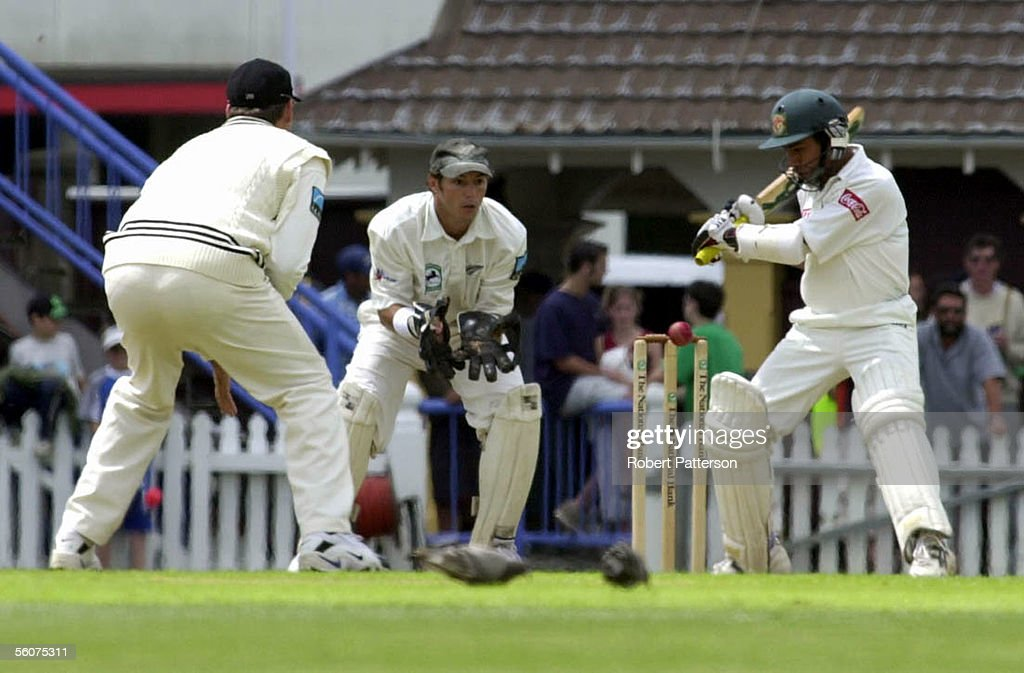 Adam Parore watches as Aminul Islam keeps a close : News Photo