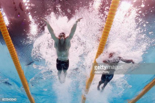 Adam Peaty of Great Britain and Joao Gomes Junior of Brazil compete during the Men's 50m Breaststroke final two on day twelve of the Budapest 2017...