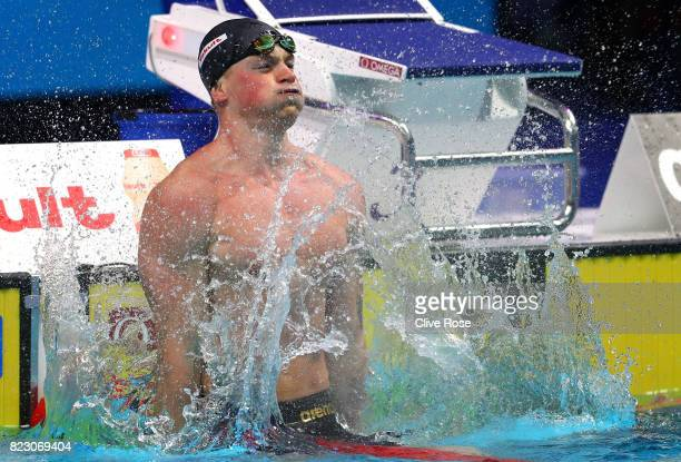 Adam Peaty of Great Britain celebrates after winning the gold medal during the Men's 50m Breaststroke final on day thirteen of the Budapest 2017 FINA...
