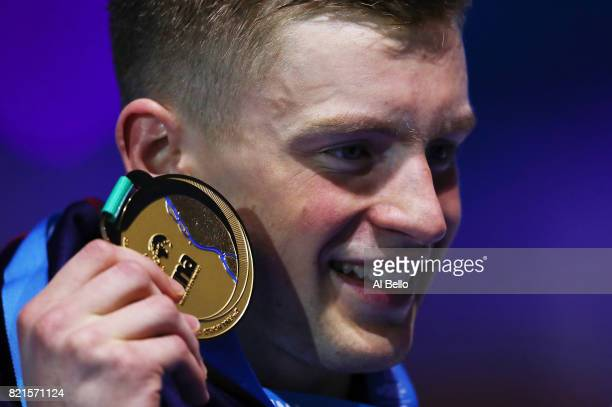Adam Peaty of Great Britain celebrates winning gold in the Men's 100m Breaststroke Final on day eleven of the Budapest 2017 FINA World Championships...