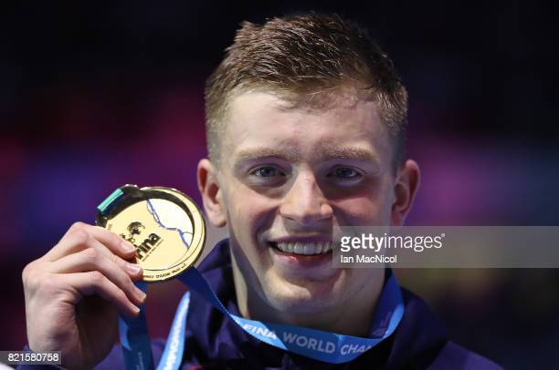 Adam Peaty of Great Britain poses with his gold medal from the final of Men's 100m Breaststroke on day eleven of the FINA World Championships at the...