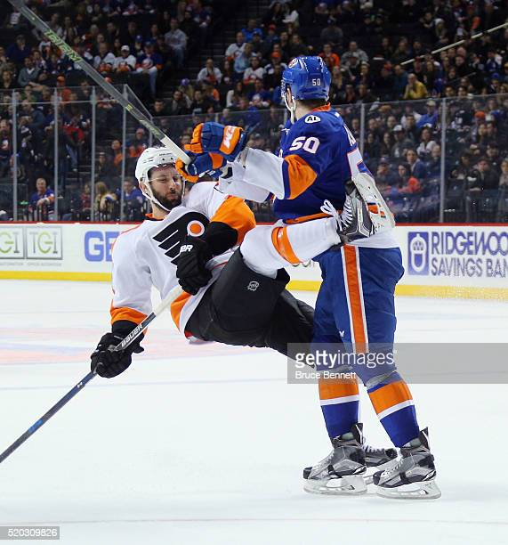Adam Pelech of the New York Islanders steps into Sam Gagner of the Philadelphia Flyers during the first period at the Barclays Center on April 10...