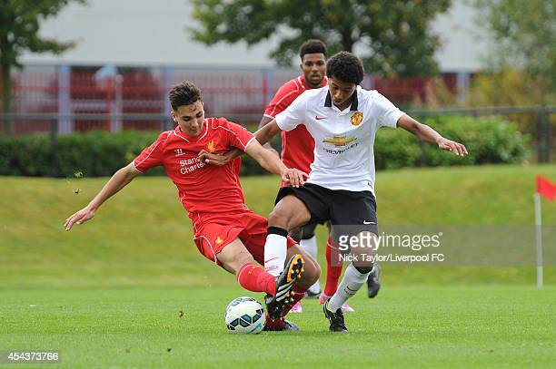 Adam Phillips of Liverpool and Devonte Redmond of Manchester United in action during the Barclays Premier League Under 18 fixture between Liverpool...