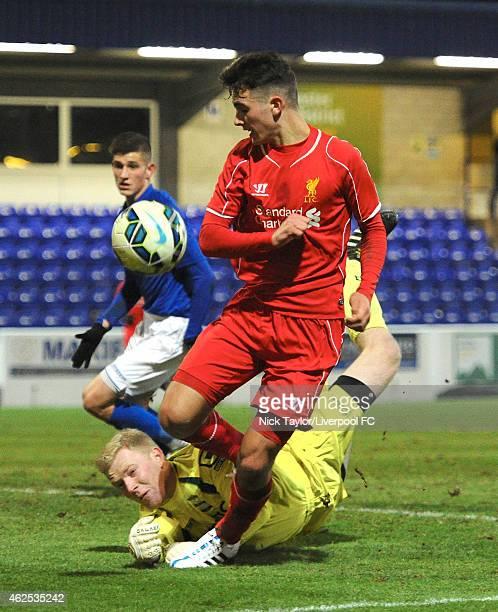 Adam Phillips of Liverpool and goalkeeper Jake Weaver of Birmingham City in action during the FA Youth Cup 5th Round match between Liverpool and...