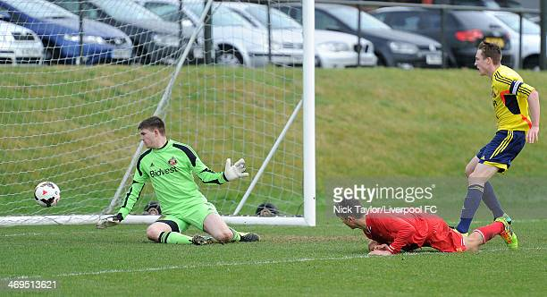 Adam Phillips of Liverpool scores a low header during the Barclays Premier League Under 18 fixture between Liverpool and Sunderland at the Liverpool...
