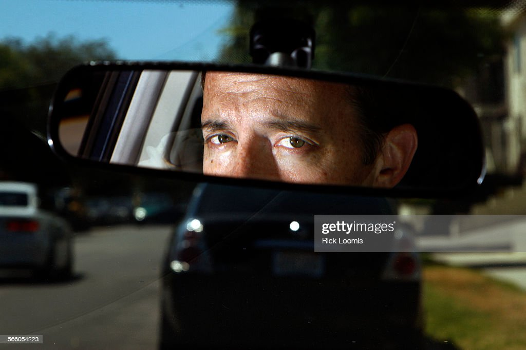 Adam Pilver inside his 2007 Honda Civic Hybrid that he is skeptical of having tuned up for fear that the Honda software upgrade will negatively...