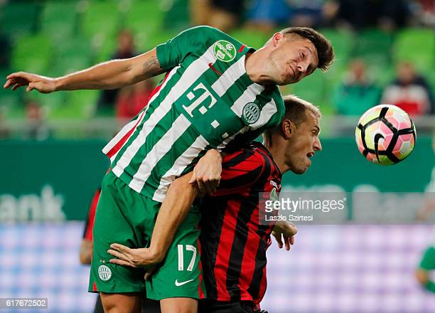 Adam Pinter of Ferencvarosi TC battles for the ball in the air with Djordje Kamber of Budapest Honved during the Hungarian OTP Bank Liga match...