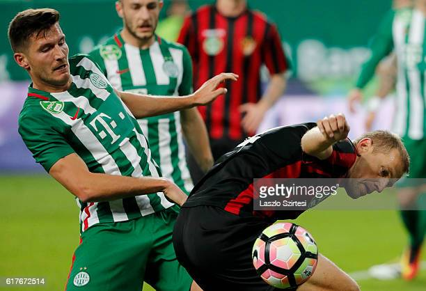 Adam Pinter of Ferencvarosi TC competes for the ball with with Djordje Kamber of Budapest Honved during the Hungarian OTP Bank Liga match between...