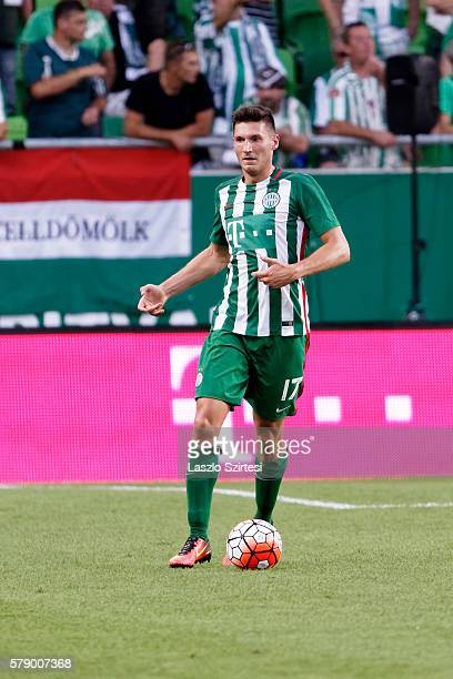 Adam Pinter of Ferencvarosi TC controls the ball during the UEFA Champions League Qualifying Round match between Ferencvarosi TC and FK Partizani at...