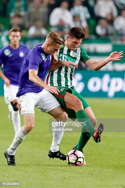 Adam Pinter of Ferencvarosi TC fights for the ball with Benjamin Cseke of Ujpest FC during the Hungarian OTP Bank Liga match between Ferencvarosi TC...