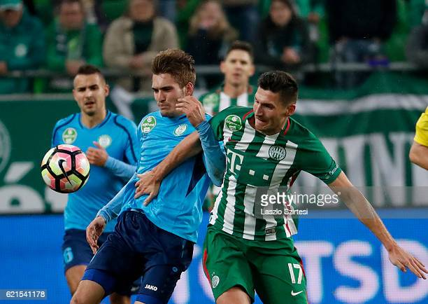 Adam Pinter of Ferencvarosi TC fights for the ball with Janos Hahn of Paksi FC before Lajos Bertus of Paksi FC during the Hungarian OTP Bank Liga...