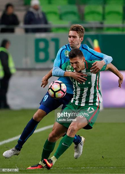 Adam Pinter of Ferencvarosi TC fights for the ball with Janos Hahn of Paksi FC during the Hungarian OTP Bank Liga match between Ferencvarosi TC and...