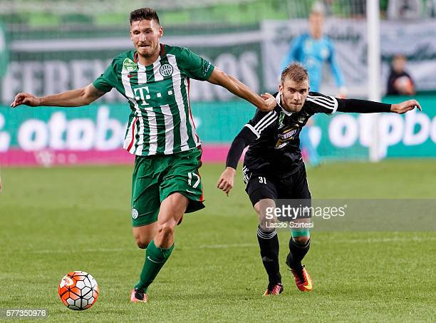 Adam Pinter of Ferencvarosi TC leaves Mario Nemeth of Swietelsky Haladas behind during the Hungarian OTP Bank Liga match between Ferencvarosi TC and...