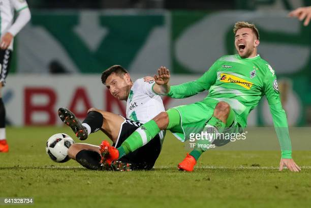 Adam Pinter of Greuther Fuerth and Christoph Kramer of Borussia Moenchengladbach battle for the ball during the DFB Cup match between SpVgg Greuther...