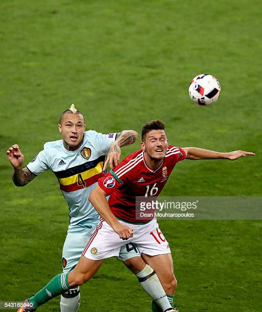 Adam Pinter of Hungary and Radja Nainggolan of Belgium compete for the ball during the UEFA EURO 2016 round of 16 match between Hungary and Belgium...