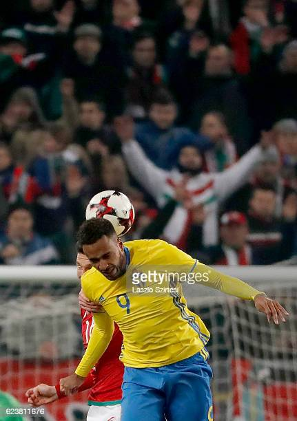 Adam Pinter of Hungary battles for the ball in the air with Isaac Kiese Thelin of Sweden during the International Friendly match between Hungary and...