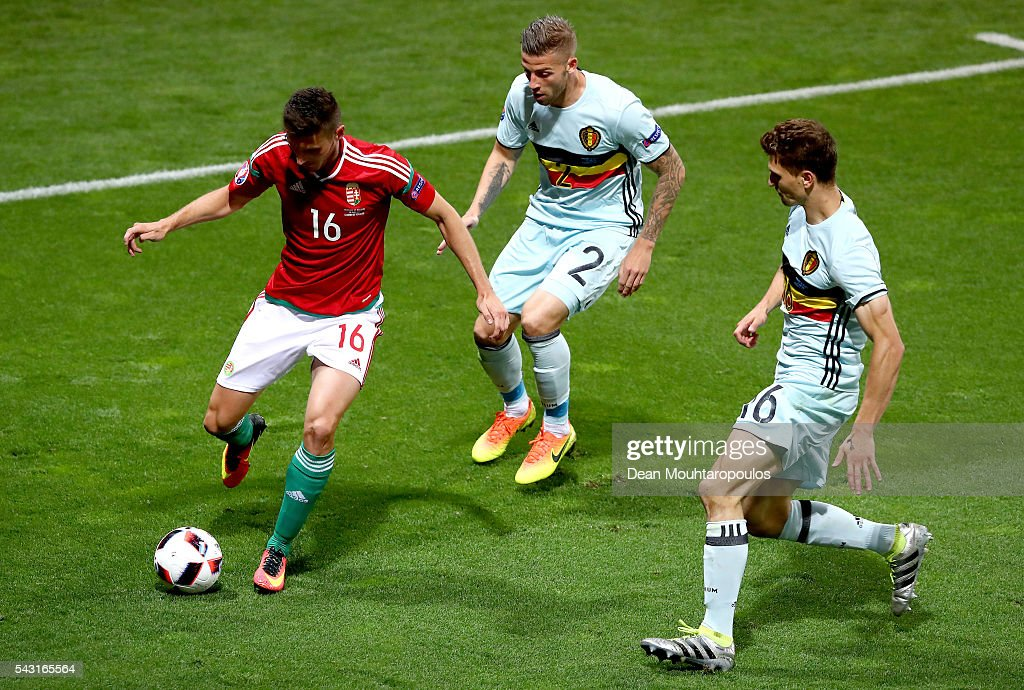 Adam Pinter (L) of Hungary competes for the ball against <a gi-track='captionPersonalityLinkClicked' href=/galleries/search?phrase=Toby+Alderweireld&family=editorial&specificpeople=653048 ng-click='$event.stopPropagation()'>Toby Alderweireld</a> (C) and <a gi-track='captionPersonalityLinkClicked' href=/galleries/search?phrase=Thomas+Meunier&family=editorial&specificpeople=8330376 ng-click='$event.stopPropagation()'>Thomas Meunier</a> (R) of Belgium during the UEFA EURO 2016 round of 16 match between Hungary and Belgium at Stadium Municipal on June 26, 2016 in Toulouse, France.