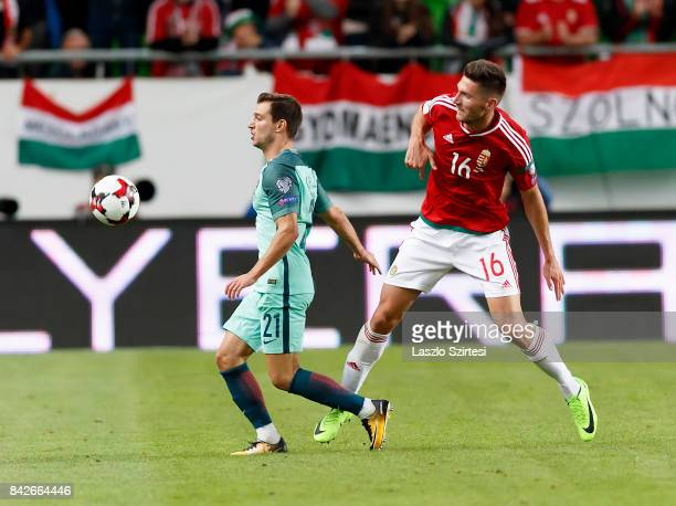 Adam Pinter of Hungary competes for the ball with Cedric of Portugal during the FIFA 2018 World Cup Qualifier match between Hungary and Portugal at...