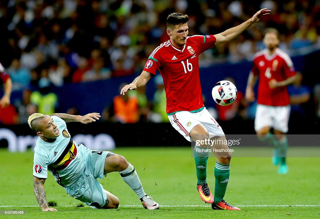 Adam Pinter of Hungary controls the ball under pressure of <a gi-track='captionPersonalityLinkClicked' href=/galleries/search?phrase=Radja+Nainggolan&family=editorial&specificpeople=6339191 ng-click='$event.stopPropagation()'>Radja Nainggolan</a> of Belgium during the UEFA EURO 2016 round of 16 match between Hungary and Belgium at Stadium Municipal on June 26, 2016 in Toulouse, France.