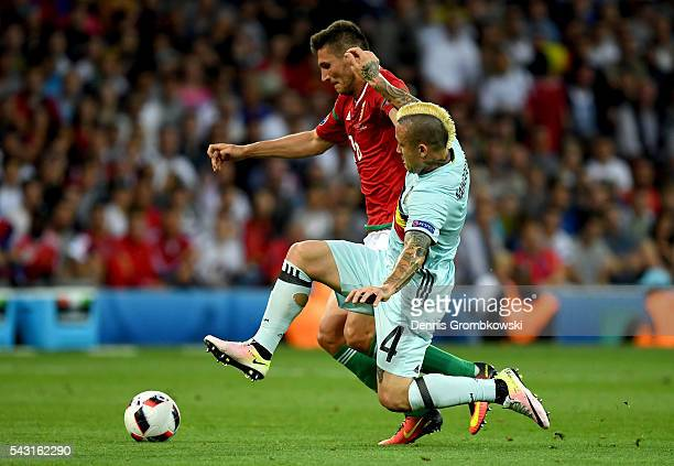 Adam Pinter of Hungary is tackled by Radja Nainggolan of Belgium during the UEFA EURO 2016 round of 16 match between Hungary and Belgium at Stadium...