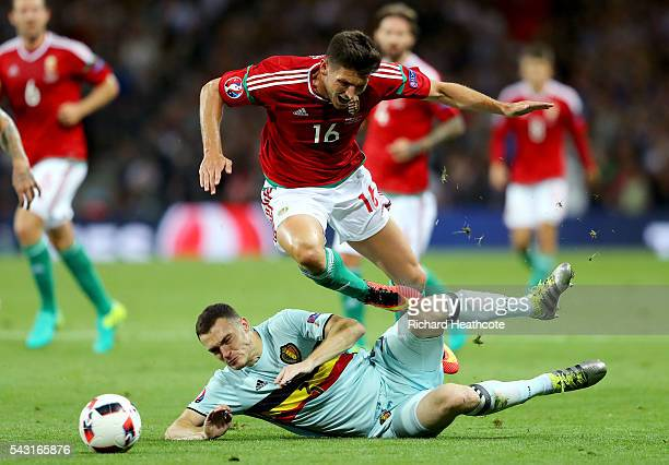 Adam Pinter of Hungary is tackled by Thomas Vermaelen of Belgium resulting in an yellow card during the UEFA EURO 2016 round of 16 match between...