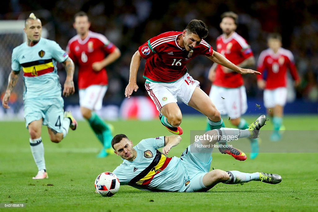 Adam Pinter of Hungary is tackled by <a gi-track='captionPersonalityLinkClicked' href=/galleries/search?phrase=Thomas+Vermaelen&family=editorial&specificpeople=1360240 ng-click='$event.stopPropagation()'>Thomas Vermaelen</a> of Belgium resulting in an yellow card during the UEFA EURO 2016 round of 16 match between Hungary and Belgium at Stadium Municipal on June 26, 2016 in Toulouse, France.