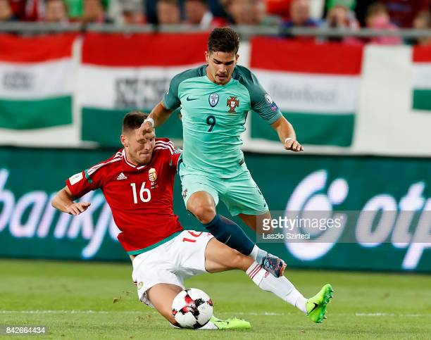 Adam Pinter of Hungary slide tackles Andre Silva of Portugal during the FIFA 2018 World Cup Qualifier match between Hungary and Portugal at Groupama...