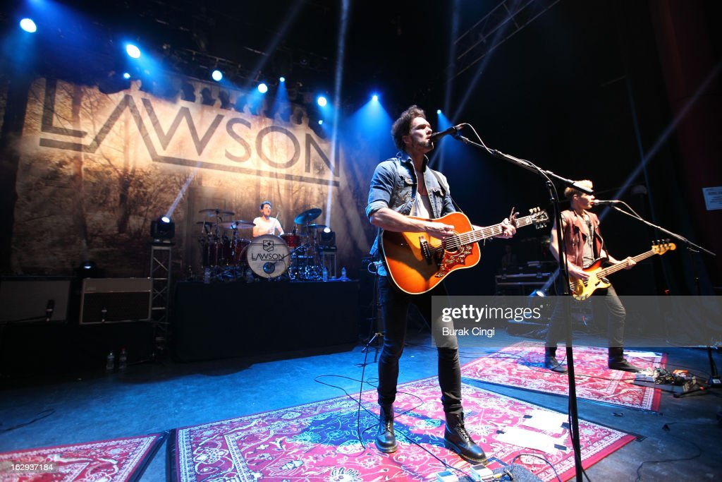 Adam Pitt and Andy Brown of Lawson perform on stage at O2 Shepherd's Bush Empire on March 1, 2013 in London, England.
