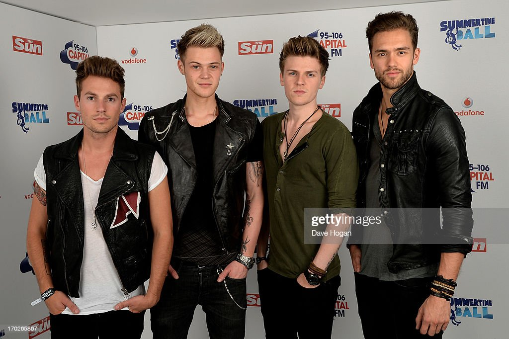 Adam Pitts Ryan Fletcher Joel Peat and Andy Brown of Lawson pose in a backstage studio during the Capital Summertime Ball at Wembley Stadium on June...