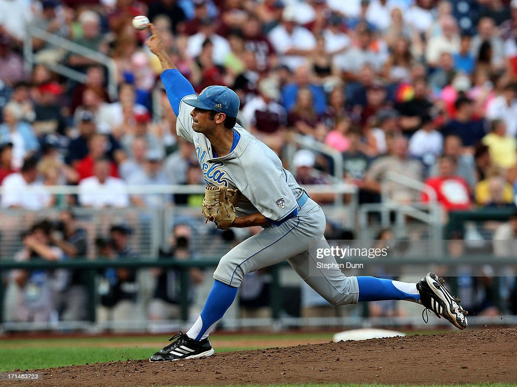 Adam Plutko #9 of the UCLA Bruins throws a pitch against the Mississippi State Bulldogs during game one of the College World Series Finals on June 24, 2013 at TD Ameritrade Park in Omaha, Nebraska. UCLA won 3-1.