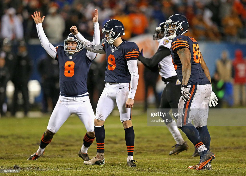 Adam Podlesh #8, Robbie Gould #9 and Martellus Bennett #83 of the Chicago Bears celebrate Gould's game-winning 38 yard field goal against the Baltimore Ravens at Soldier Field on November 17, 2013 in Chicago, Illinois. The Bears defeated the Ravens 23-20 in overtime.