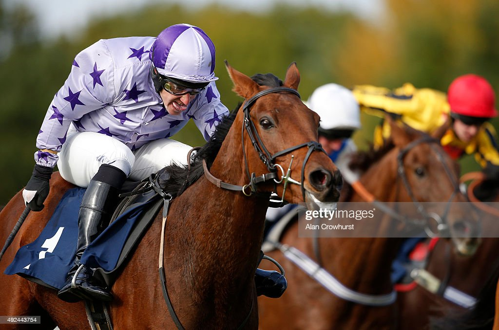 Adam Pogson riding Kayfton Pete clear the last to win The 32Redcom Handicap Steeple Chase at Huntingdon racecourse on October 13 2015 in Huntingdon...