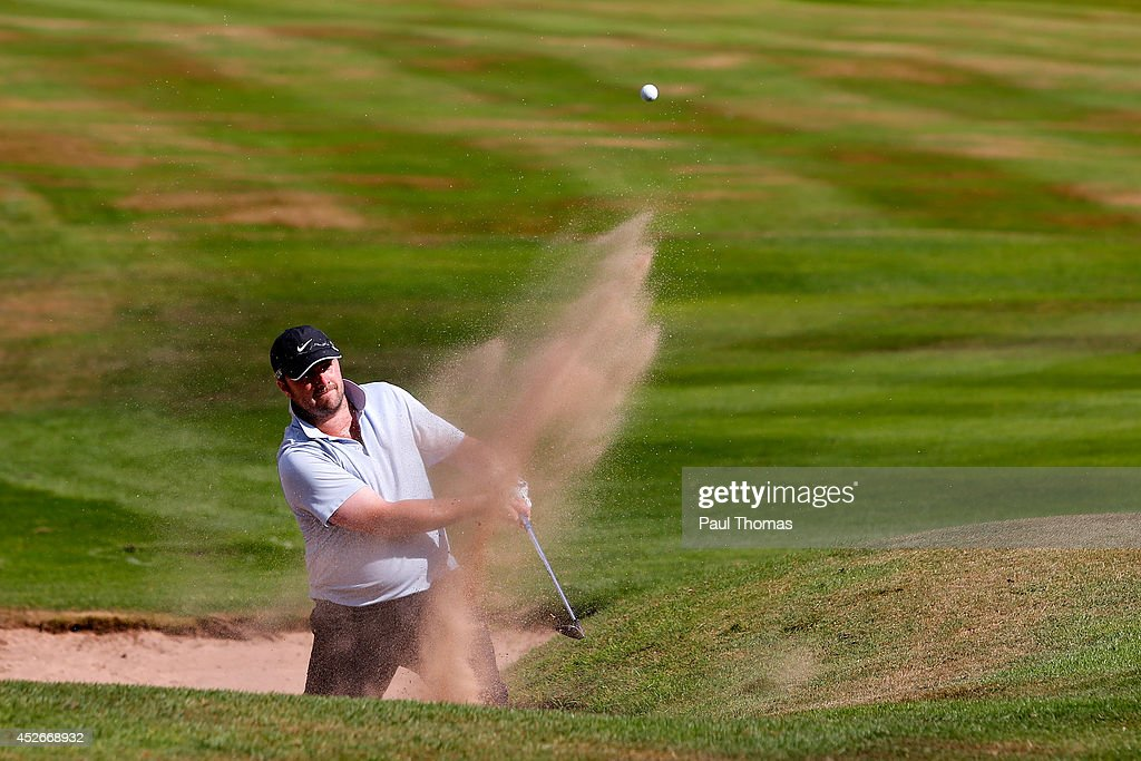 Adam Powell of Hartford Golf Club plays a shot during The Lombard Trophy North West Regional Qualifier at Dunham Forest Golf Club on July 25, 2014 in Altrincham, England.