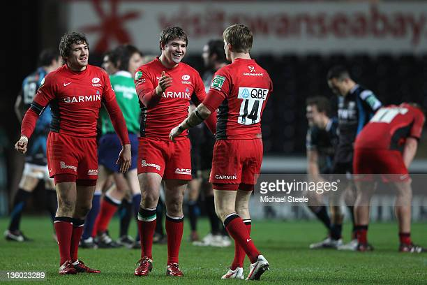Adam Powell of Saracens celebrates his sides victory with Dave Strettle during the Heineken Cup Pool Five match between Ospreys and Saracens at the...