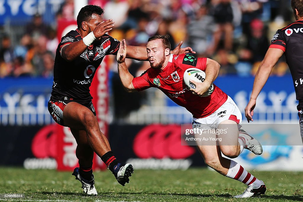 Adam Quinlan of the Dragons makes a run against Jazz Tevaga of the Warriors during the round nine NRL match between the New Zealand Warriors and the St George Illawarra Dragons at Mt Smart Stadium on May 1, 2016 in Auckland, New Zealand.