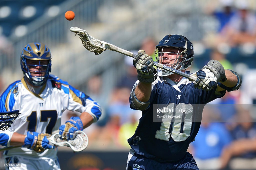 Adam Rand #10 of the Chesapeake Bayhawks grabs a loose ball in front of Geoff Snider #17 of the Charlotte Hounds during the MLL Championship at PPL Park on August 25, 2013 in Chester, Pennsylvania.
