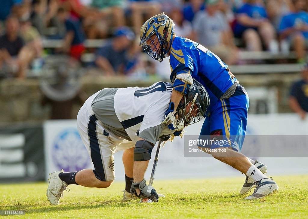 Adam Rand #10 of the Chesapeake Bayhawks is tied up by Tim Fallon #77 of the Charlotte Hounds as they battle for a faceoff at American Legion Memorial Stadium on June 22, 2013 in Charlotte, North Carolina. The Hounds defeated the Bayhawks 16-15 in overtime.