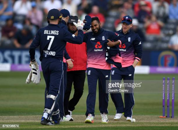 Adam Rashid of England is congratulated as he leaves the field after picking up a five wicket haul during the Royal London One Day International...