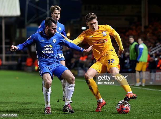 Adam Reach of Preston holds off pressure from Michael Smith of Peterborough during the FA Cup Third Round match between Peterborough United and...