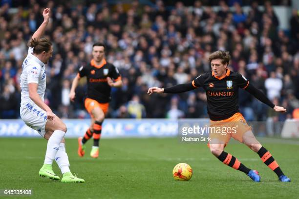 Adam Reach of Sheffield Wednesday and Luke Ayling of Leeds United in action during the Sky Bet Championship match between Leeds United and Sheffield...