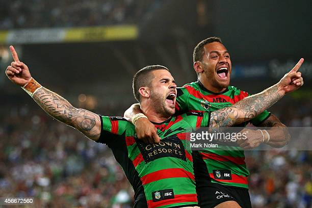 Adam Reynolds and Apisai Koroisau of the Rabbitohs celebrate after a try during the 2014 NRL Grand Final match between the South Sydney Rabbitohs and...