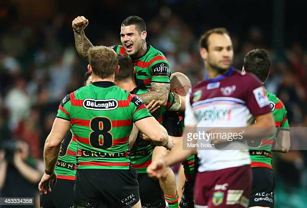 Adam Reynolds and other Rabbitohs team mates celebrate a try by Sam Burgess during the round 22 AFL match between the South Sydney Rabbitohs and the...